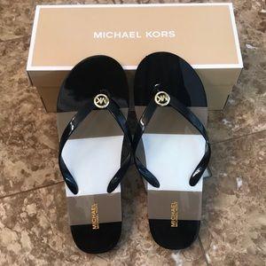 4eb04ff4d288d5 Michael Kors Shoes - NIB MICHAEL KORS Shiny Flip Flops sz 10